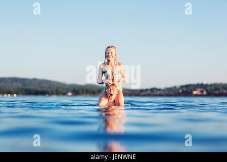 Girl and boy in lake - Stock Photo