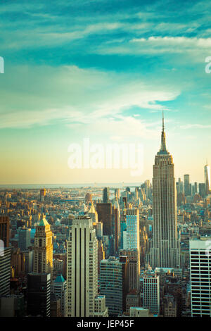 View of New York City skyline seen from midtown Manhattan looking downtown. This image has vintage tone filter. - Stock Photo