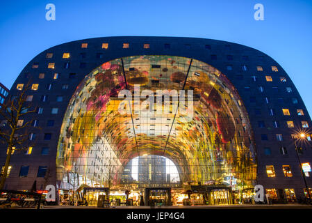 Exterior night view of the new and colored Market Hall (Markthal in Dutch), located in the Blaak district in Rotterdam, - Stock Photo