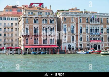 Venice Veneto Italy view over the facade of palaces on Grand Canal. Ca' Giustinian built in the second half of  - Stock Photo