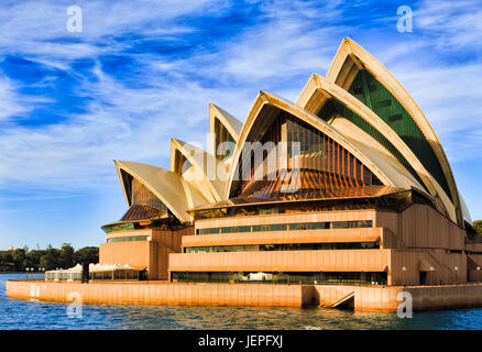 Sydney, AUstralia - 24 June 2017: Sydney Opera house on a bright sunny day rising from Sydney harbour waters in - Stock Photo