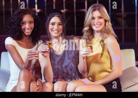 Pretty girls having shots - Stock Photo