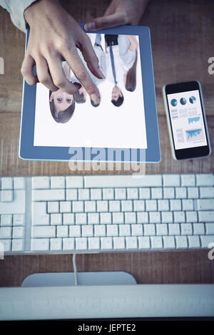 Composite image of business graphs - Stock Photo