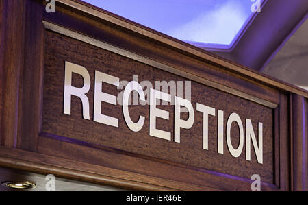 Old sign of reception in a hotel, detail of information for tourists - Stock Photo