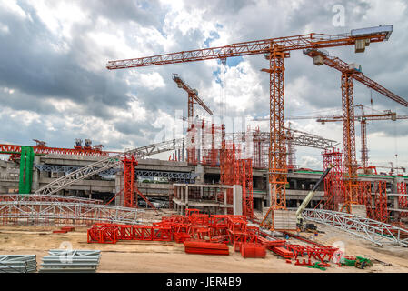 Cranes Working on Expressway Construction Sites in Asia - Stock Photo