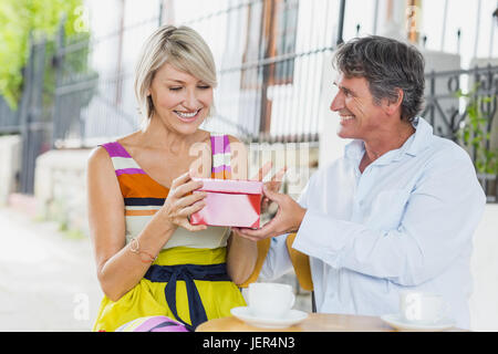 Woman receiving gift from man - Stock Photo