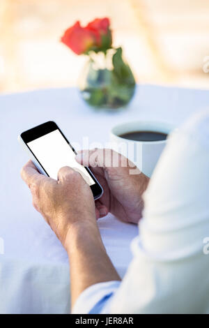 Close up of masculine hands using smartphone - Stock Photo