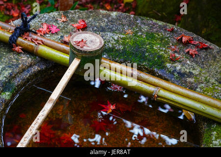 Water dipper on a stone basin at Koto-in Temple in Kyoto, Japan - Stock Photo