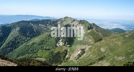 view to Maly Krivan hill from highest hill of Mala Fatra mountains - Velky Krivan during nice spring day with clear - Stock Photo