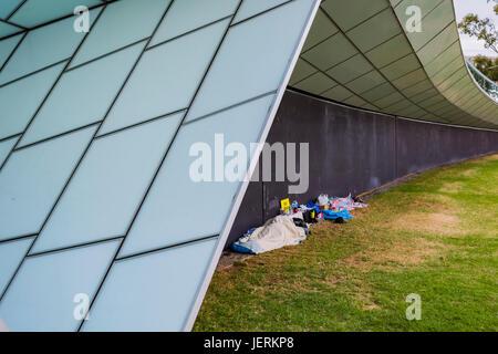 Homeless people sleeping under the River Torrens footbridge in Adelaide, South Australia - Stock Photo