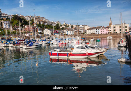 14 June 2017: Ilfracombe, Devon, England, UK - Boats in the harbour on a bright summer day. - Stock Photo
