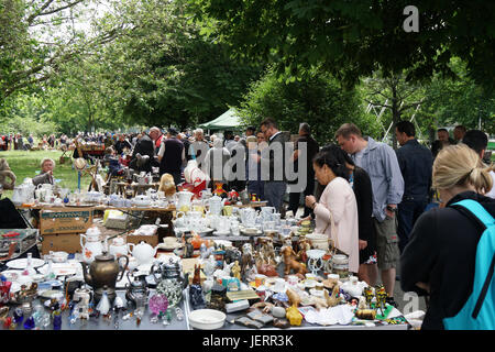 people shopping at a bric a brac sale in the village hall southwold stock photo royalty free. Black Bedroom Furniture Sets. Home Design Ideas
