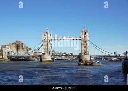 LONDON, UNITED KINGDOM - APRIL 09: Tower Bridge in London on APRIL 09, 2017. Bascule Tower Bridge Over Thames River - Stock Photo