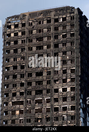 Burnt-out shell of Grenfell Tower housing tower after fire disaster in London,UK - Stock Photo