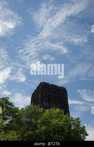 Twelve days after the devastating fire that killed an unspecified number of people in Grenfell Tower, the charred - Stock Photo