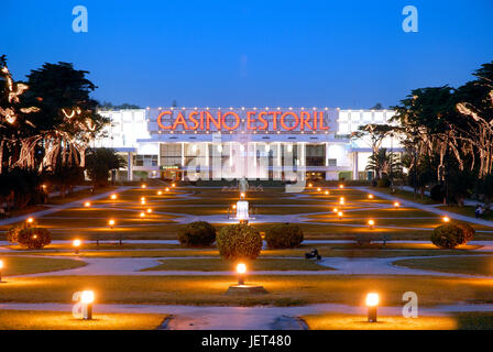Casino Estoril gardens at twilight. Estoril, Portugal - Stock Photo