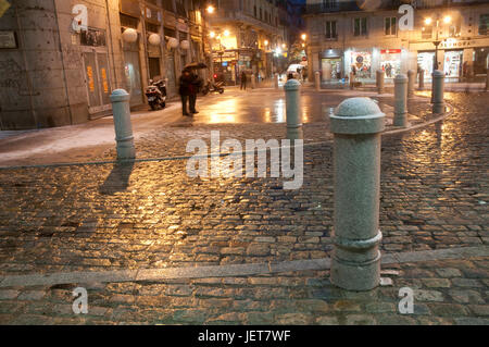 Wet and snow covered pavement, night view. Puerta del Sol, Madrid, Spain. - Stock Photo