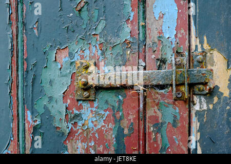 old metal latch on weathered shed door - Stock Photo