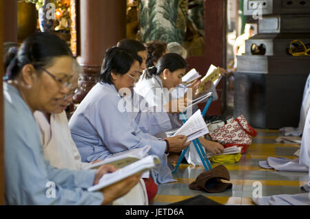 Buddhist women, read, pray, Long Son Pagode, Nha Trang, Vietnam, - Stock Photo