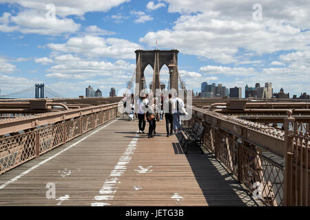 walking over the brooklyn bridge New York City USA - Stock Photo