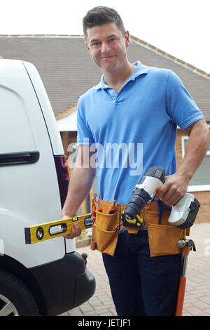 Portrait Of Builder With Van Outside House - Stock Photo
