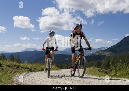 Mountain biker on the way, Mountainbiker unterwegs - Stock Photo