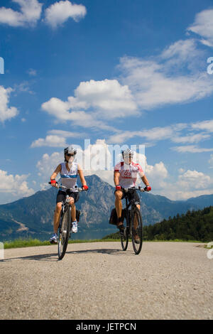 Family excursion in the mountains by the bicycle, Familienausflug im Gebirge mit dem Fahrrad - Stock Photo