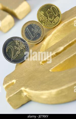 Eurocoins on eurosign, Euromuenzen auf Eurozeichen - Stock Photo