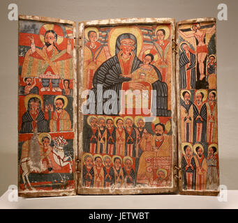 Triptych with Mary, scenes of the life of Jesus and Saints. Ethiopian Christian art. End of 17th Century. Paint - Stock Photo