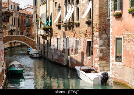 Ancient buildings and boats on a canal in the historic center of Venice, Veneto, Italy, Europe - Stock Photo