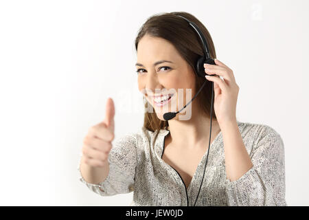 Portrait of a phone operator looking at you and gesturing thumbs up on a white background - Stock Photo