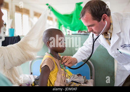 An expat missionary doctor works on the pediatric ward at Bundibugyo Hospital, Uganda.