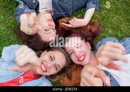 Happy friends in the park on a sunny day . Summer lifestyle portrait of three women enjoy nice day. Best friends - Stock Photo
