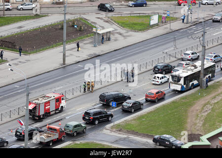 ST.PETERSBURG, RUSSIA-CIRCA MAY, 2017: Firefighters are near crashed cars on city street. Crash between several - Stock Photo
