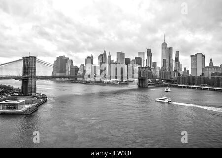 New York Skyline from Manhattan Bridge Black and White - Stock Photo