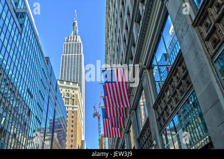 Empire State Building and US Flag - Stock Photo