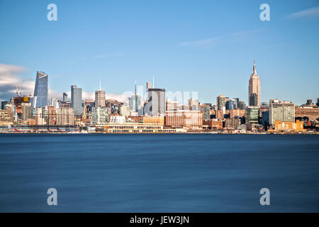 Empire State Building and Midtown Manhattan as seen from Hoboken - Stock Photo