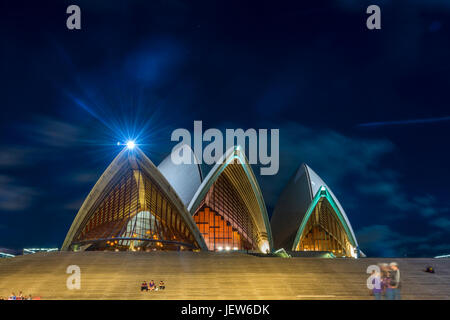 Sydney Opera house with staircase at night with moon, long exposure - Stock Photo