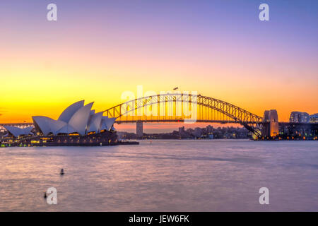 View on Sydney Opera house and harbour bridge at sunset - Stock Photo