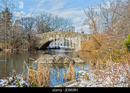 Gapstow Bridge in Central Park New York with Snow - Stock Photo