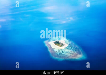 Heart shape island in Maldives, Indian Ocean. Aearial view. - Stock Photo