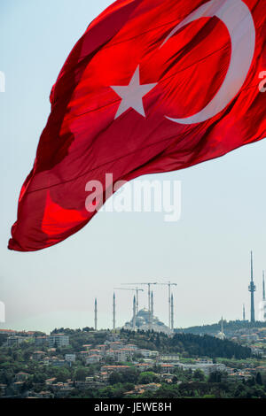 The national flag of Turkey flying over the Çamlıca Mosque under construction in Istanbul. - Stock Photo