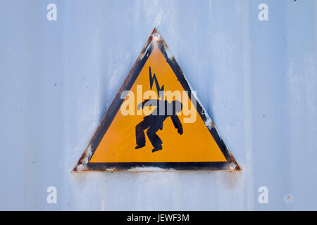 A sign warning of the dangers of electrocution - Stock Photo