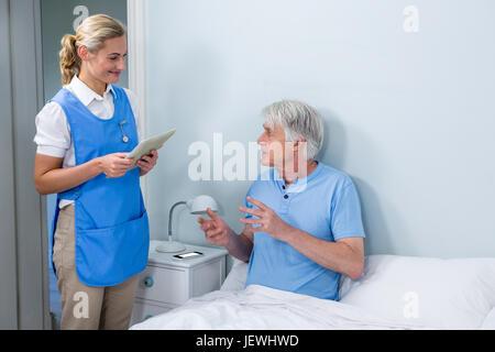 Nurse holding digital tablet at hospital - Stock Photo