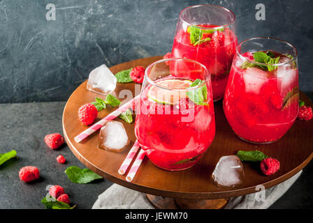 Summer refreshing non-alcoholic cocktails. Fruit drinks. Raspberry mojito lemonade with fresh organic mint and lime. - Stock Photo