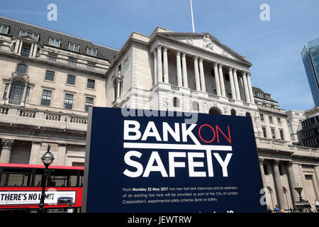 'Bank on Safety'  taxi campaign sign outside the Bank of England on Threadneedle Street in financial district City - Stock Photo