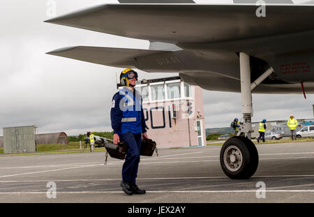 Official Media Assignment at RNAS Culdrose, Helston, Cornwall, UK. 27th June, 2017. An aircraft Handler under the - Stock Photo