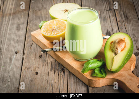 Healthy food. Dietary breakfast or snack. Green smoothies from yoghurt, avocado, banana, apple, spinach and lemon. - Stock Photo