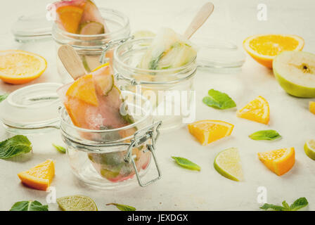 Homemade ice cream. Frozen drinks. Fresh fruits, citrus. Popsicles of red, white sangria, lemonade or mojito. With - Stock Photo