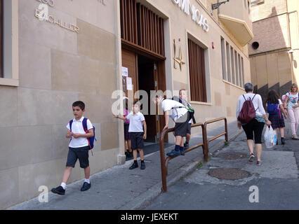Children leaving Santo Tomas Dominicas school in Pamplona in Northern Spain - Stock Photo